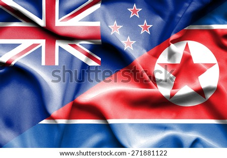 Waving flag of North Korea and New Zealand