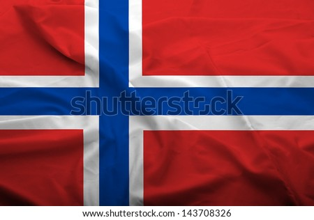 Waving flag of Norway. Flag has real fabric texture. - stock photo