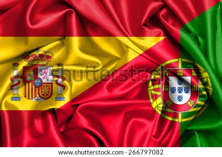 Waving flag of Portugal and Spain - stock photo