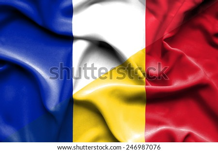 Waving flag of Romania and France - stock photo
