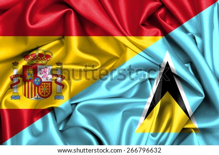 Waving flag of Saint Lucia and Spain - stock photo