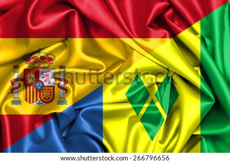 Waving flag of Saint Vincent Grenadines and Spain - stock photo