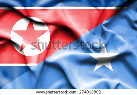 Waving flag of Somalia and North Korea