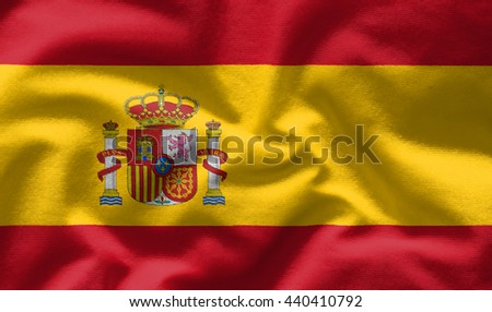 Waving flag of Spain. Flag has real fabric texture - stock photo