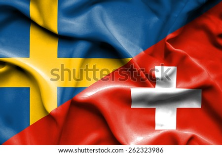 Waving flag of Switzerland and Sweden - stock photo