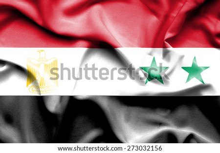 Waving flag of Syria and Egypt - stock photo