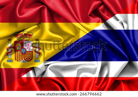 Waving flag of Thailand and Spain - stock photo