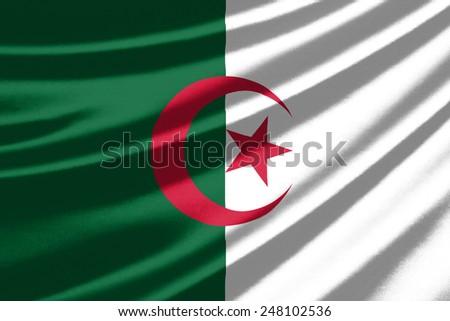 Waving flag of the Algeria - stock photo
