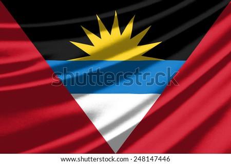 Waving flag of the Antigua and Barbuda - stock photo