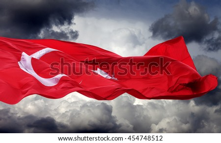 Waving flag of Turkey against storm clouds - stock photo