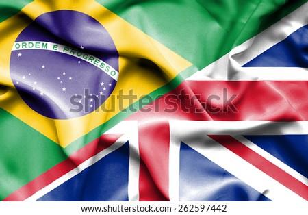 Waving flag of United Kingdon and Brazil - stock photo