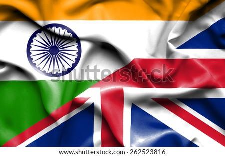 Waving flag of United Kingdon and India - stock photo