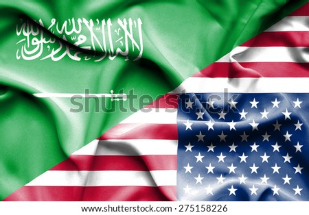 Waving flag of United States of America and Saudi Arabia - stock photo