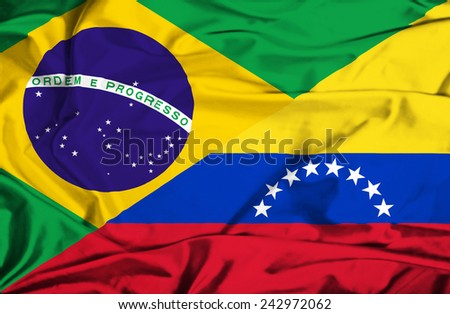 Waving flag of Venezuela and Brazil - stock photo