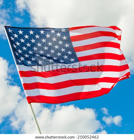 Waving in the wind USA flag with white clouds on background - 1 to 1 ratio - stock photo