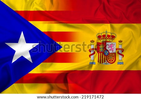 Waving Spain and Independent Catalonia Flag - stock photo