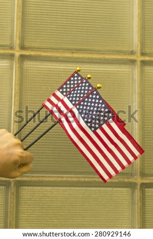 Waving three American flags in support the United States and freedom