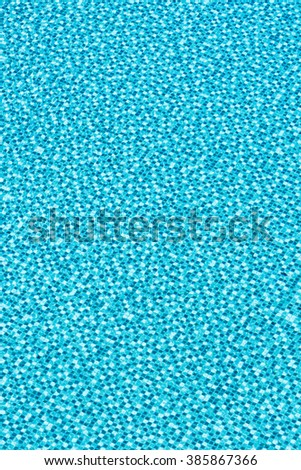 Waving water surface and Texture blue tile under clear water in the swimming pool - stock photo