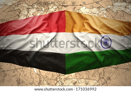 Waving Yemeni and Indian flags on the of the political map of the world - stock photo