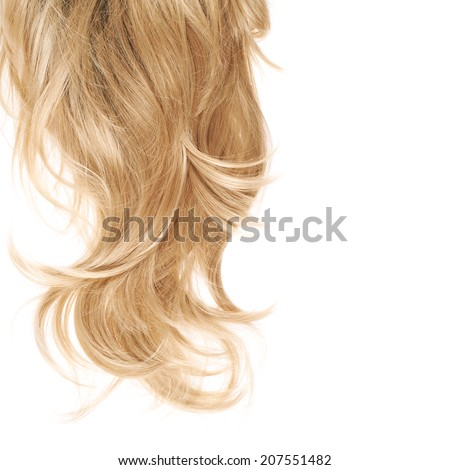 Wavy hair fragment placed over the white background as a copyspace backdrop composition - stock photo