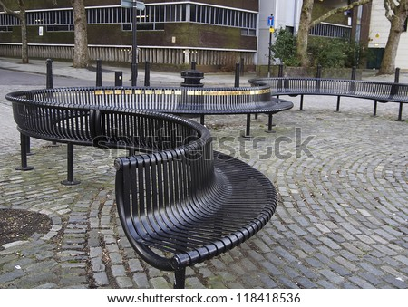 Wavy shaped metal bench seating in Bristol city centre - stock photo