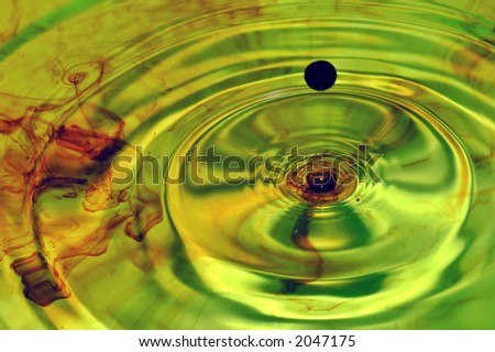 Wavy water with drop - stock photo
