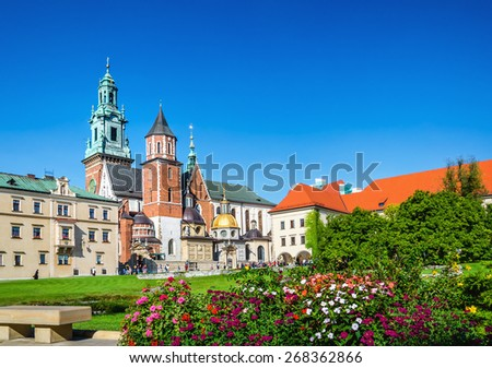 Wawel Castle and cathedral square with flowers in foreground in Krakow, Poland - stock photo