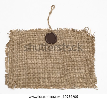 wax seal on sackcloth material on white - stock photo