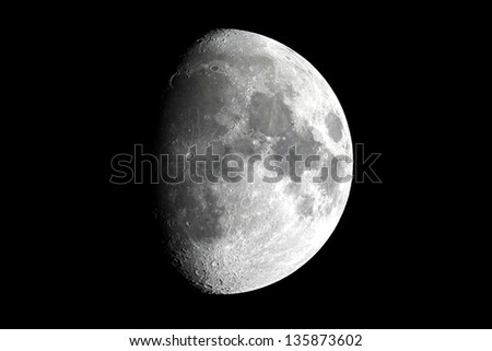 Waxing Gibbous Moon on black background - stock photo