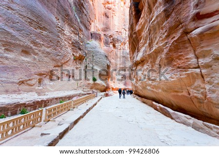way through Siq gorge to stone city Petra, Jordan - stock photo
