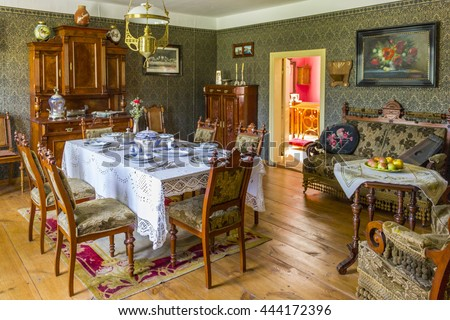 WDZYDZE KISZEWSKIE, POLAND - AUGUST 14: Interior of the old country cottage with exposed household on August 14, 2011 in Wdzydze Kiszewskie.