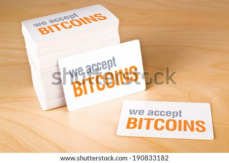 We accept bitcoins Business cards with rounded corners. Stack of blank horizontal business cards propped up another. - stock photo