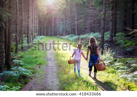 We are going to pick mushrooms - stock photo