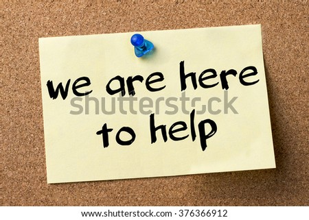 We are here to help - adhesive label pinned on bulletin board - horizontal image - stock photo
