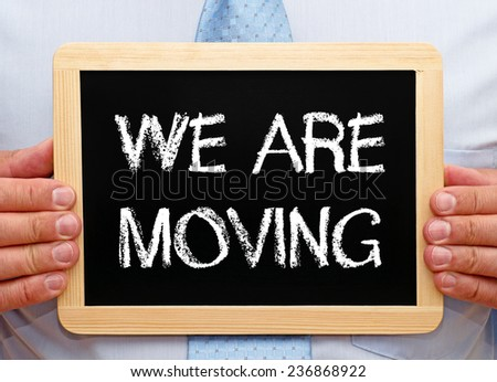 We are moving - Businessman with chalkboard