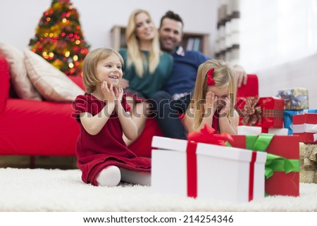 We can't wait to open Christmas gifts  - stock photo