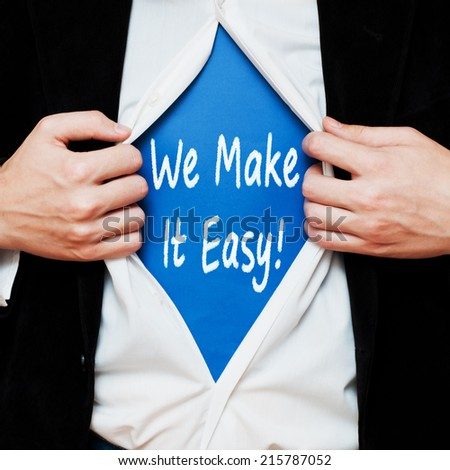 We make it easy ! Businessman showing a superhero suit underneath his shirt with a business message text written on it. - stock photo