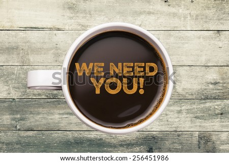 we need you. coffee cup with wood background - stock photo
