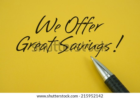 We Offer Great Savings! note with pen on yellow background