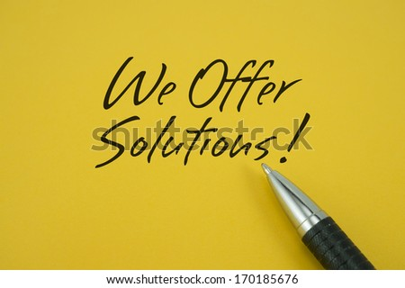 We Offer Solutions! note with pen on yellow background