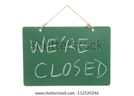 We're closed words on green board hanging and isolated on white - stock photo