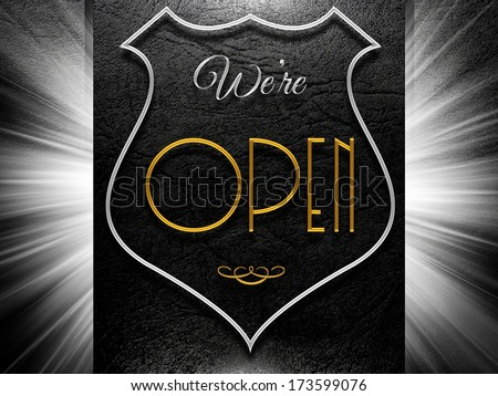 We're open sign on black leather background - stock photo