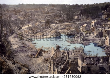 We sure liberated the hell out of this place', remarked a U.S. soldier. Saint Lo, France was 95% destroyed before it was captured from Germans on July 18, 1944. B&W Photo with oil color. - stock photo