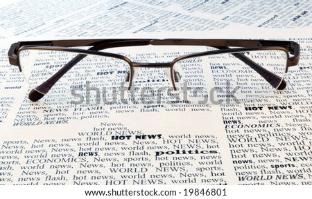 we take all news, glasses above a newspaper closeup - stock photo