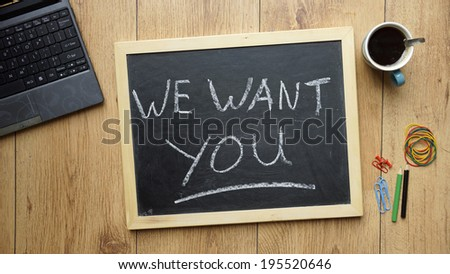 We want you written on a chalckboard at the office - stock photo