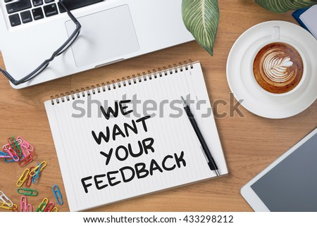 We want your feedback Tablet with blank black screen and coffee cup - stock photo