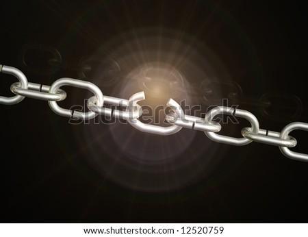 Weak chain breaks open with subtle golden light flare on black background. - stock photo