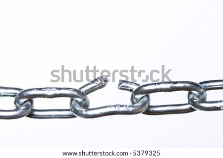 Weak link in a chain, close-up with shallow depth of field. - stock photo