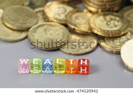 Wealth word written on colorful dice - Finance concept