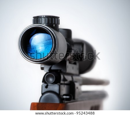 weapon gun target concept. Closeup of a sniper rifle telescope glass lens isolated - stock photo